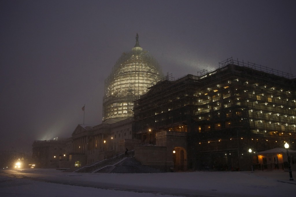 Snow falls on the East Front of the U.S. Capitol in Washington. REUTERS/Jonathan Ernst