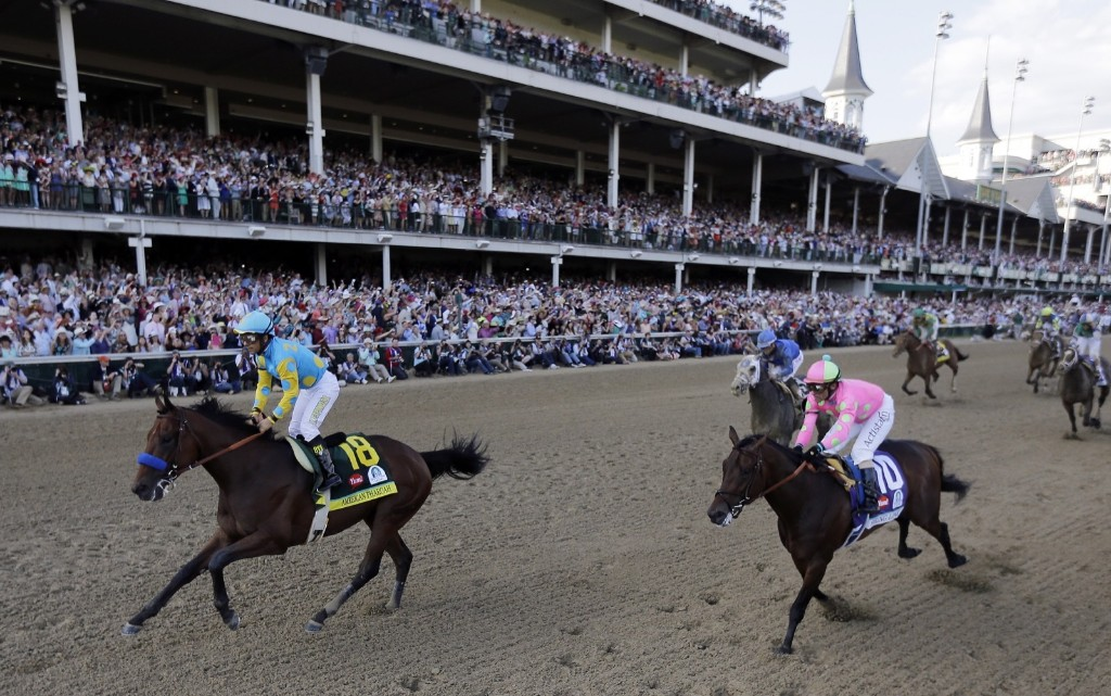 Victor Espinoza rides American Pharoah to victory in the 141st running of the Kentucky Derby, at Churchill Downs, Saturday, in Louisville. AP Photo/David J. Phillip