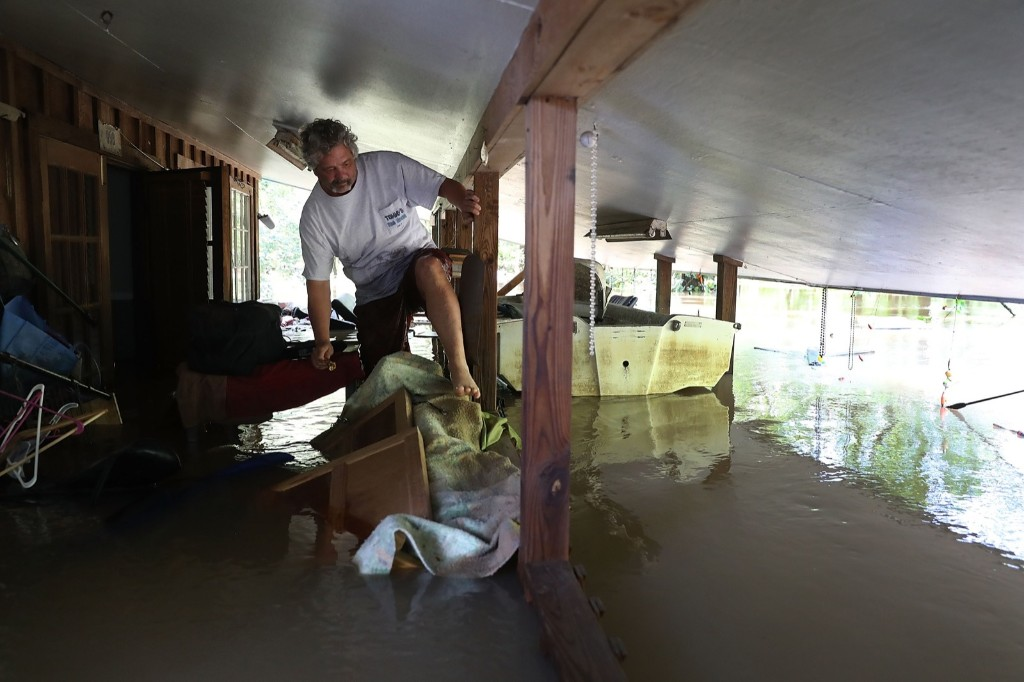 Thomas Williams walks along his flooded patio as he evacuates his home in Port Vincent, La. Joe Raedle/Getty Images