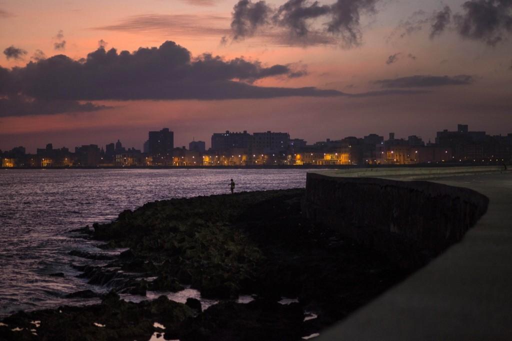 A fisherman casts his line along the Malecon in Havana. AP Photo/Ramon Espinosa