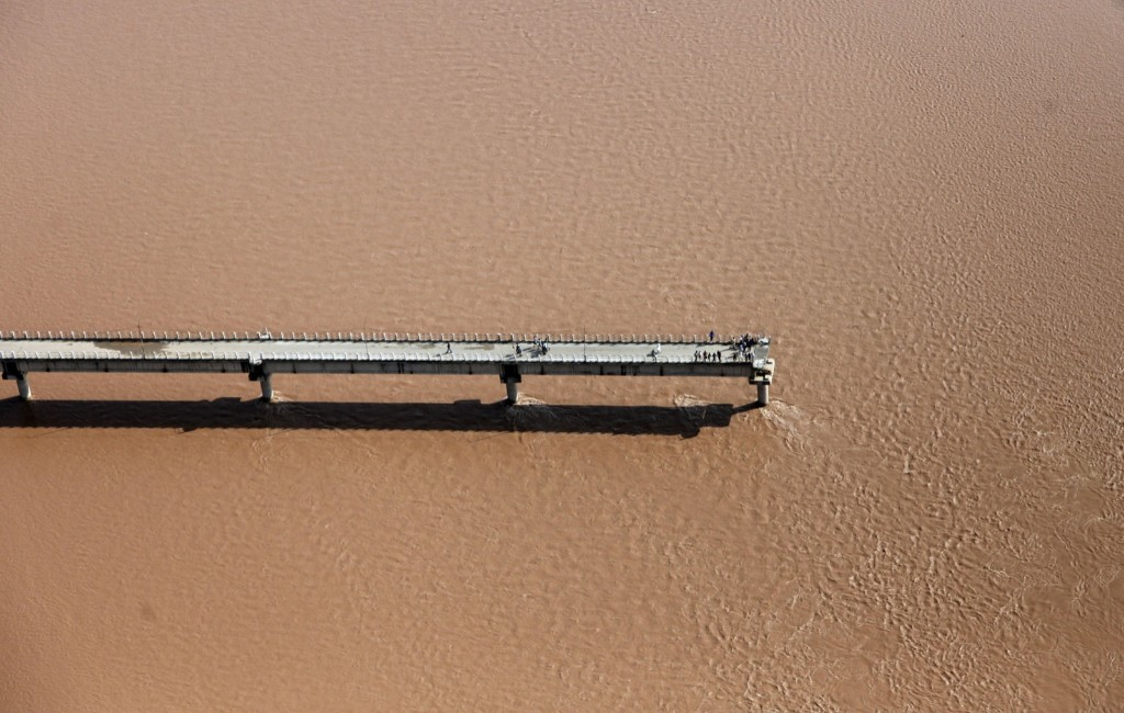 A damaged bridge across the River Tawi on the outskirts of Jammu, India. AP Photo/Channi Anand