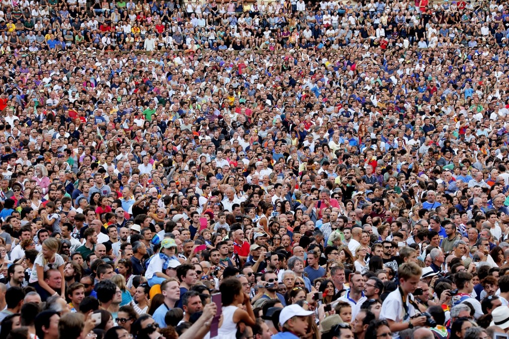 People are seen in Del Campo square during the Palio di Siena horse race in Siena August 17. REUTERS/Fabio Muzzi