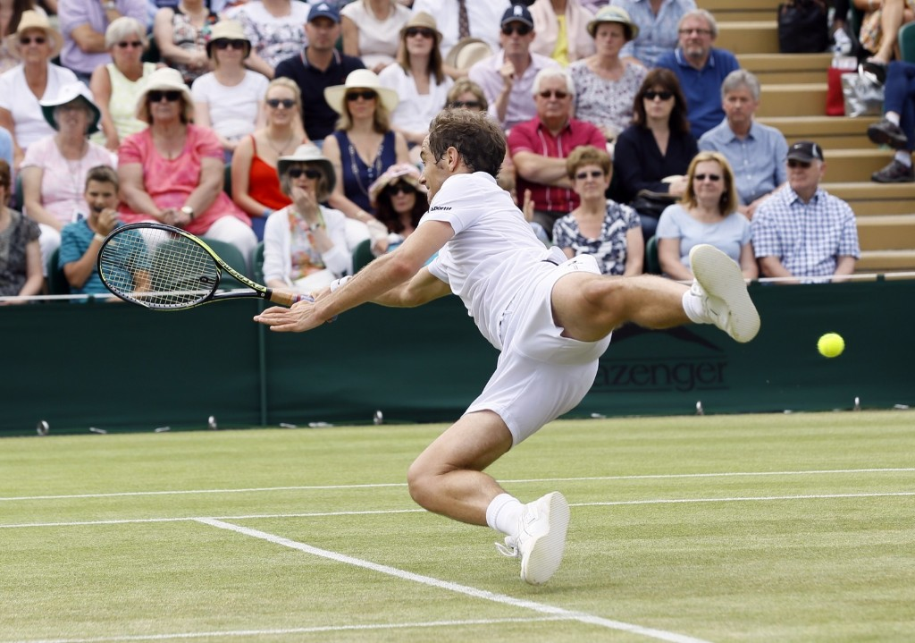 Richard Gasquet of France leaps for a shot during his singles match against Nick Kyrgios. AP Photo/Kirsty Wigglesworth