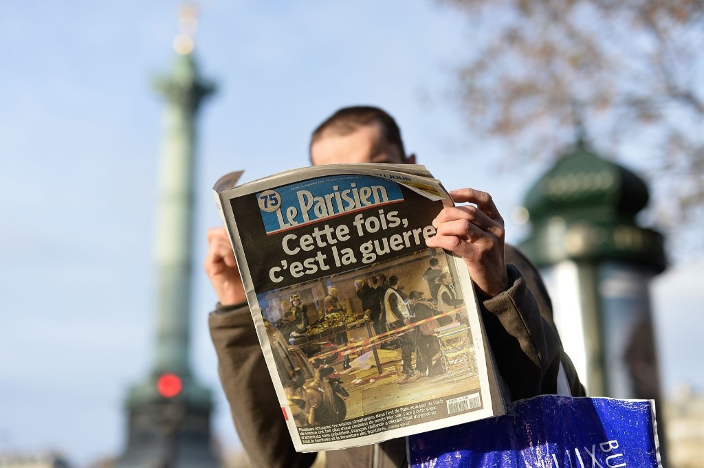 A man reads a French newspaper in Paris. Pascal Le Segretain/Getty Images