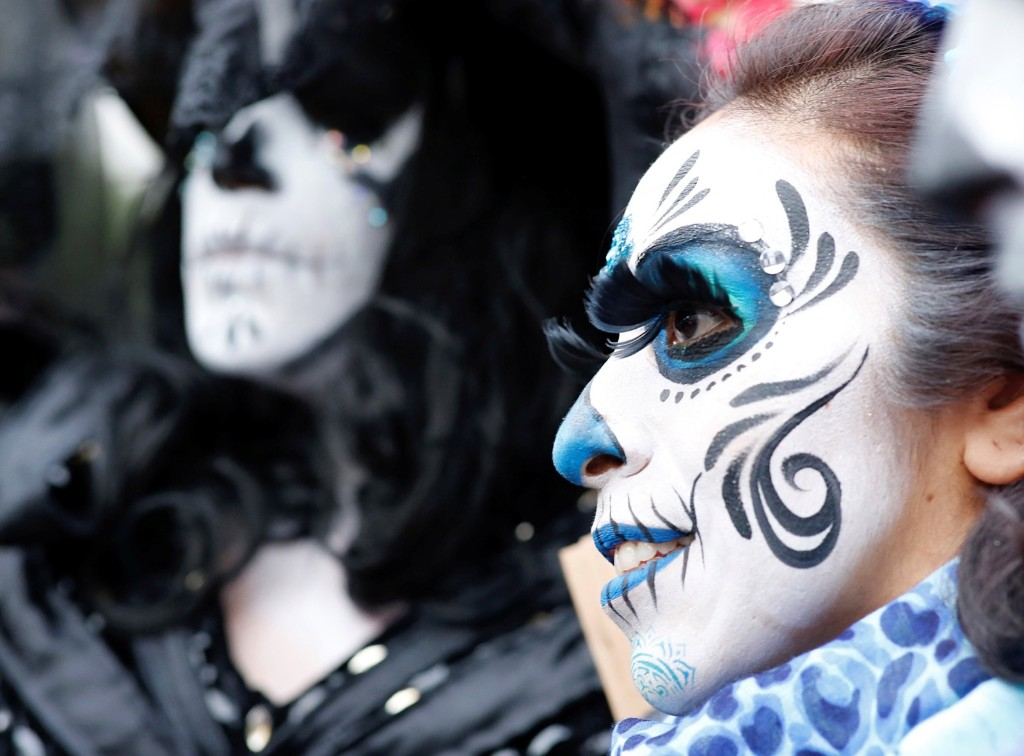 """People dressed up as Catrina, also known as """"The Elegant Death."""" REUTERS/Andres Stapff"""