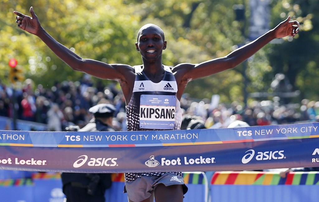 Wilson Kipsang of Kenya celebrates as he hits the tape to win the mens division. AP Photo/Kathy Willens