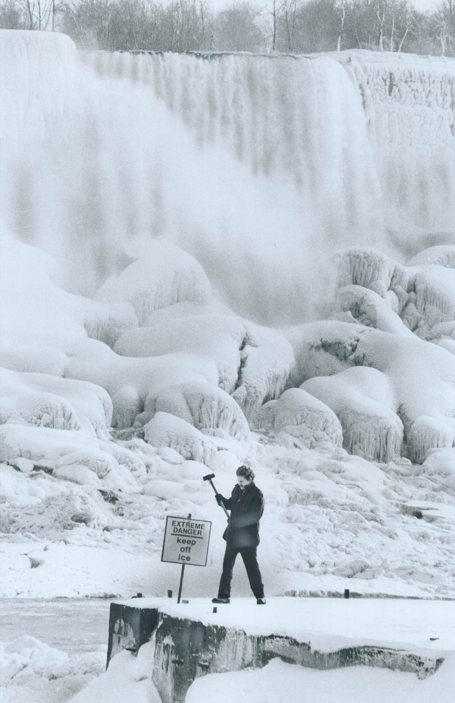 The ice bridge at the base of Niagara Falls averages five to ten feet thick as Earl Lafferty, of the Niagara Parks Commission puts up a warning sign in January 1976. Toronto Star/Getty Images