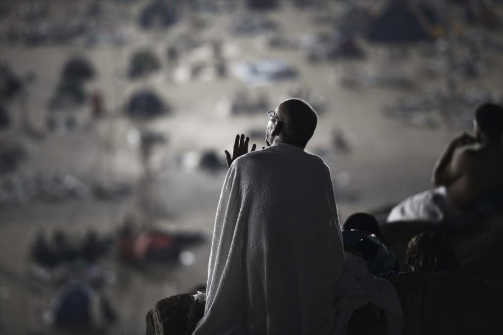 A Muslim pilgrim prays between the hills of Al-Safa and Al-Marwah in Saudi Arabia during Hajj MOHAMMED AL-SHAIKH/AFP/Getty Images
