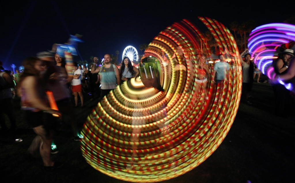 A concert-goer uses an illuminated hula hoop during performance by Canadian electrofunk duo Chromeo at Coachella. REUTERS/Mario Anzuoni