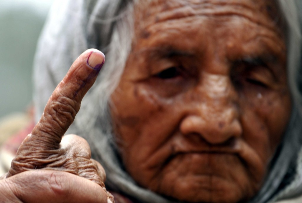 A 100 year-old lady showing her ink-marked finger after she cast her vote at polling station during assembly elections in Jammu, India. Nitin Kanotra/Hindustan Times/Getty Images