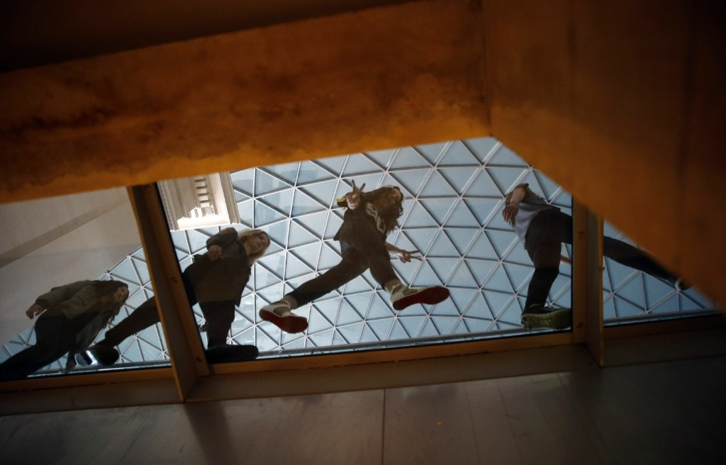 Models walk on a glass walkway during rehearsal before the presentation of the Jonathan Saunders Spring/Summer collection at the British Museum. REUTERS/Suzanne Plunkett