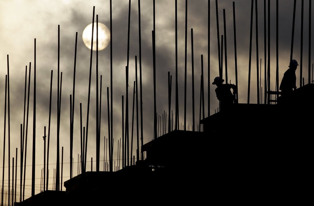 Labourers work during sunrise at a construction site in Puer, Yunnan province, China. REUTERS/Wong Campion