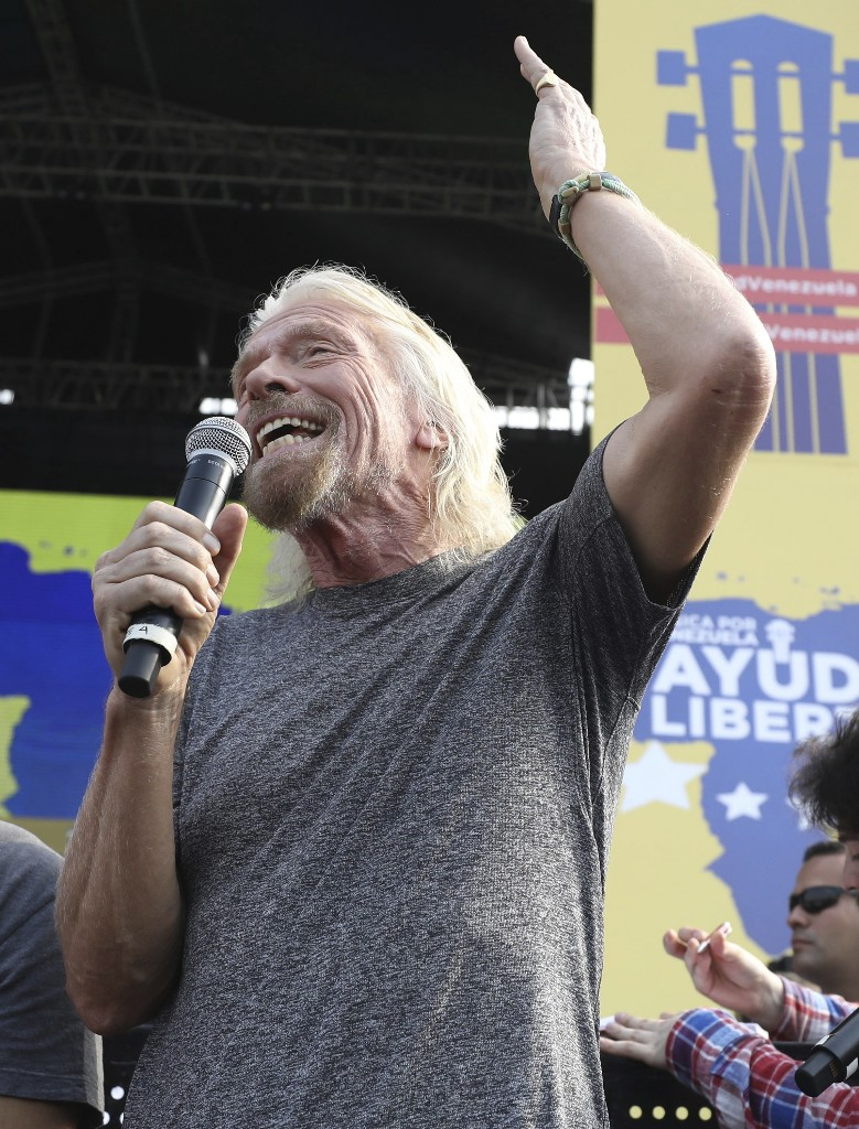 Venezuela Aid Live concert organizer Sir Richard Branson speaks to the crowd prior to the start of the concert on the Colombian side of the Tienditas International Bridge on the outskirts of Cucuta, Colombia, on the border with Venezuela, Friday, Feb. 22, 2019. Venezuela's power struggle is set to convert into a battle of the bands Friday when musicians demanding Nicolas Maduro allow in humanitarian aid and those supporting the embattled leader's refusal sing in rival concerts being held at both sides of a border bridge where tons of donated food and medicine are being stored. (AP Photo/Fernando Vergara)