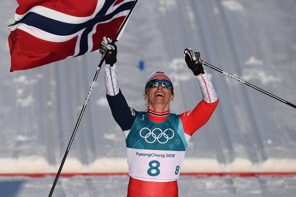Norway's Marit Bjoergen celebrates winning the women's 30km cross country mass start classic, her 15th career Olympic medal. FRANCK FIFE/AFP/Getty Images