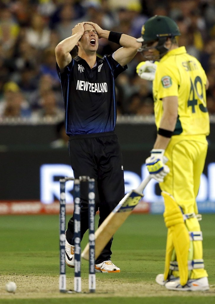 New Zealand's Matt Henry reacts after bowling a delivery to Australia's Steven Smith and the ball nearly hitting the stumps during their Cricket World Cup final match, in Melbourne, Sunday. REUTERS/Jason Reed