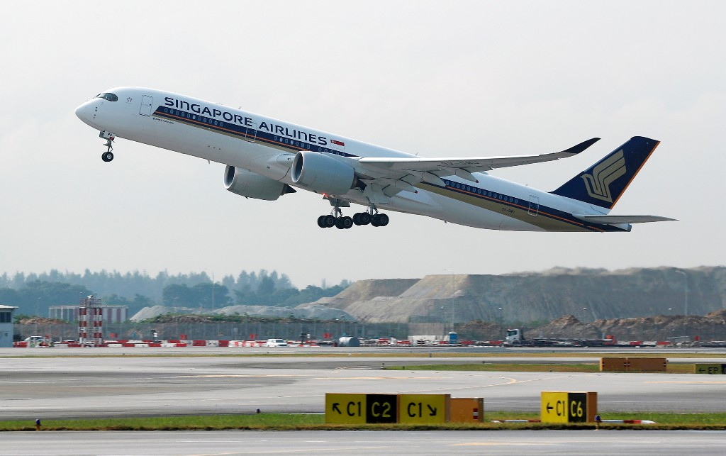 A Singapore Airlines Airbus A350-900 plane takes off at Changi Airport in Singapore March 28, 2018. REUTERS/Edgar Su/File Photo