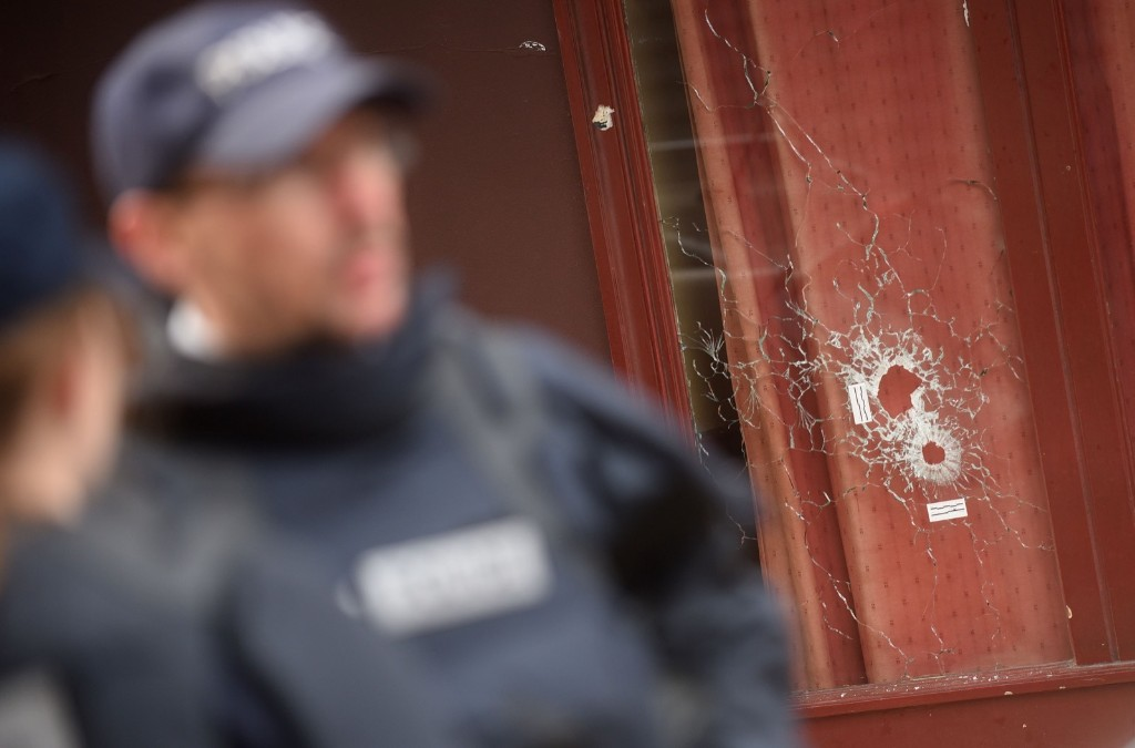 Gun bullet impacts in the windows of Le Carillon bar. Antoine Antoniol/Getty Images