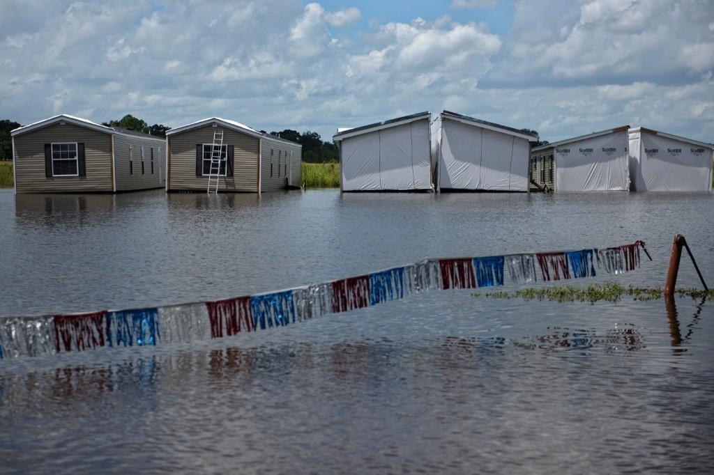 Prefabricated homes in flood water in Gonzales, La. BRENDAN SMIALOWSKI/AFP/Getty Images
