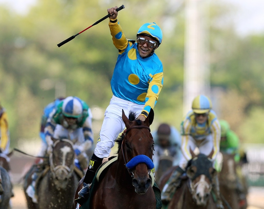 Jockey Victor Espinoza celebrates as he guides American Pharoah after crossing the finish line to win the 141st running of the Kentucky Derby, at Churchill Downs, Saturday, in Louisville. Chris Graythen/Getty Images