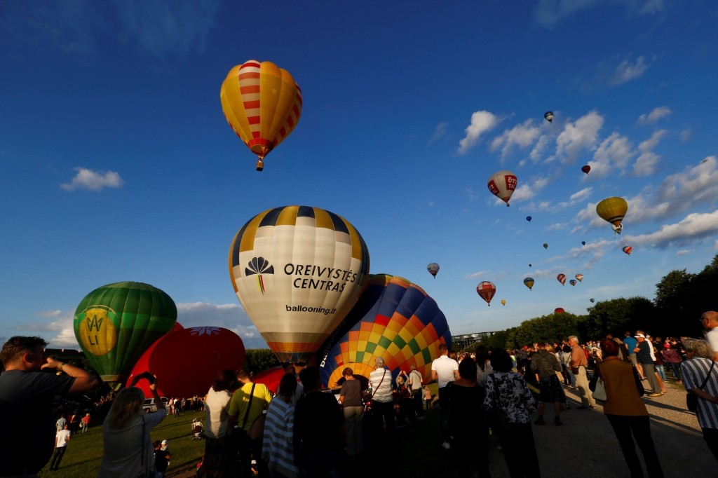 Hot air balloons take part in the Wind of Freedom 100 hot air balloon fiesta in Kaunas, Lithuania. REUTERS/Ints Kalnins
