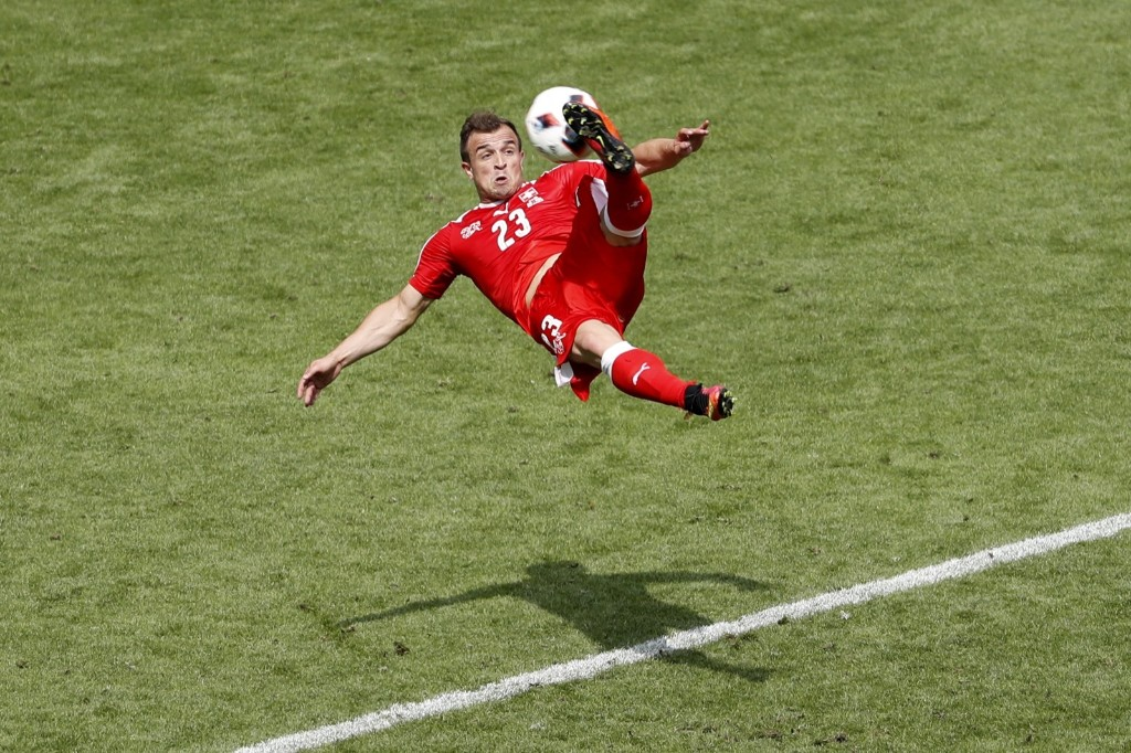 Switzerland's Xherdan Shaqiri scores goal to tie match against Switzerland during knockout round of Euro 2016 in France. Poland got through on penalty kicks. REUTERS/Max Rossi