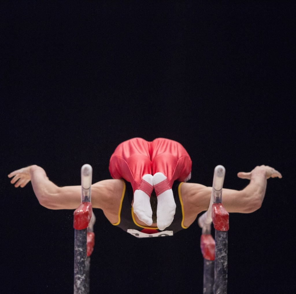Maxime Gentges of Belgium on the parallel bars at the World Gymnastics Championships in Glasgow. EPA/Robert Perry