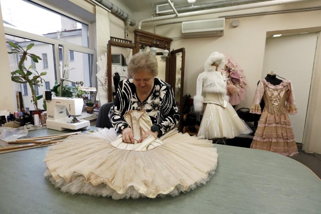 "A seamstress prepares a costume for Nacho Duato's ballet ""The Nutcracker"" at the Mikhailovsky Theatre in St. Petersburg, Russia November 19. REUTERS/Grigory Dukor"