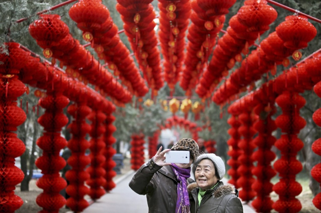 Visitors take a selfie in front of lantern decorations installed for Spring Festival celebrations in Beijing. REUTERS/Stringer
