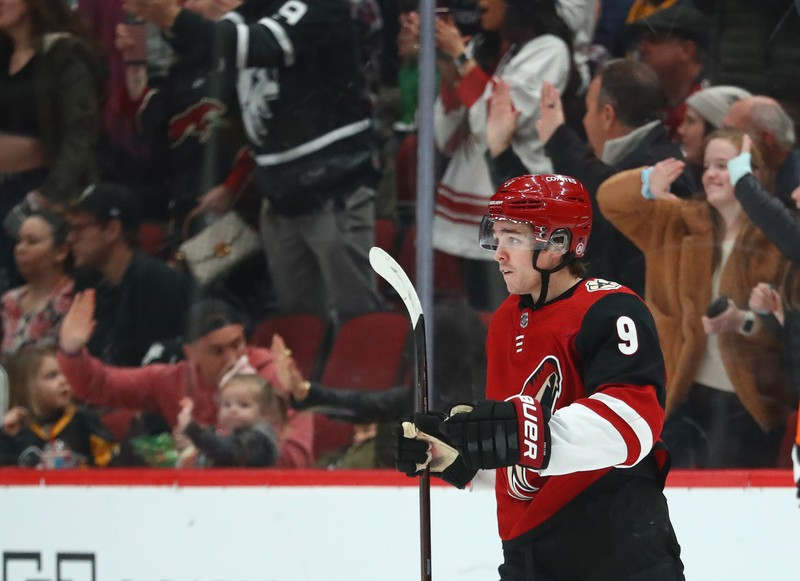Jan 18, 2019; Glendale, AZ, USA; Arizona Coyotes center Clayton Keller (9) celebrates scoring after a goal against the Pittsburgh Penguins in the first period at Gila River Arena. Mandatory Credit: Mark J. Rebilas-USA TODAY Sports