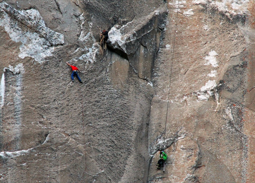 Tommy Caldwell, in red, climbs pitch 19 while cameraman Brett Lowell records the movement, lower right. AP Photo/Tom Evans/elcapreport