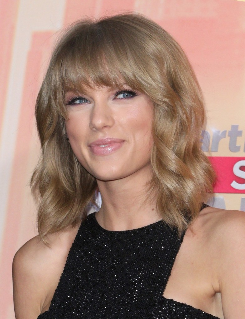 """Taylor Swift, winner of the awards for best lyrics for """"Blank Space"""", song of the year for """"Shake It Off"""" and artist of the year, in the press room at the iHeartRadio Music Awards, Sunday, in Los Angeles. John Salangsang/Invision/AP"""