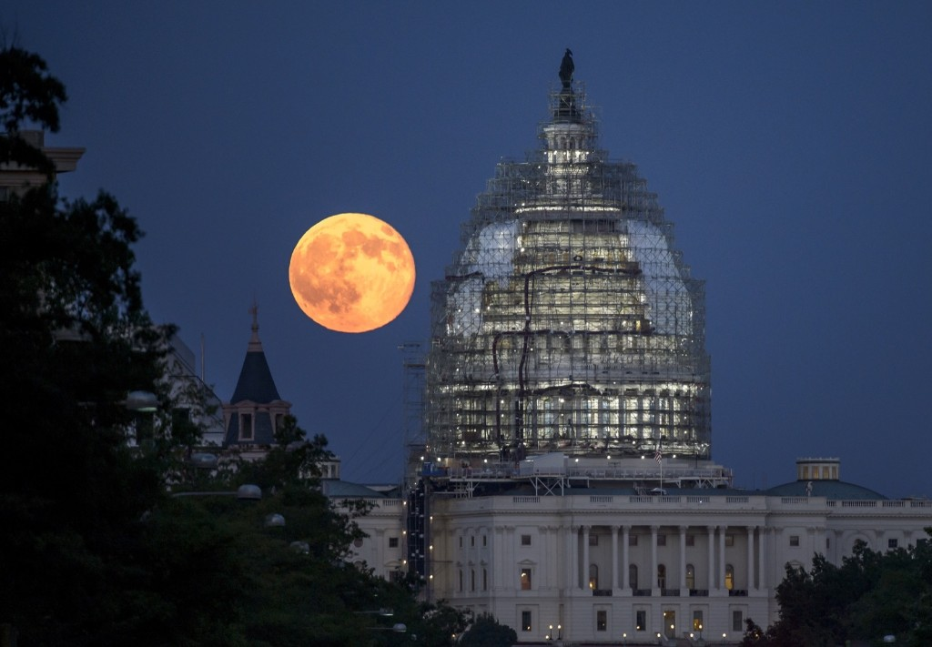 A second full moon for the month of July rises behind the dome of the U.S. Capitol in Washington, DC. Bill Ingalls/NASA via Getty Images