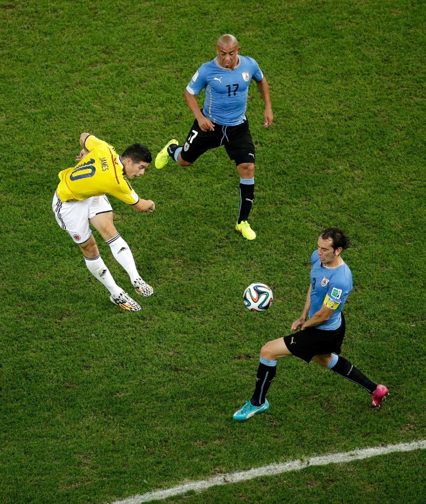 James Rodriguez of Colombia shoots and scores his team's first goal. Felipe Dana/Pool/Getty Images