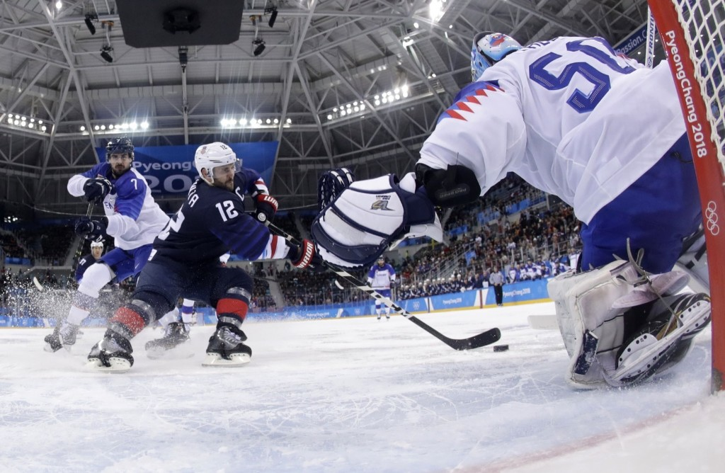 Brian Gionta of the U.S. trying to get off a shot against goalie Jan Laco of Slovakia. REUTERS/Julio Cortez/Pool