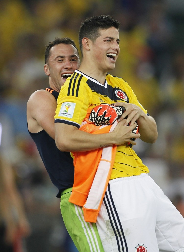 James Rodriguez celebrating with goalkeeper David Ospina after his two goals paced Colombia to 2-0 victory over Uruguay. Gary Hershorn/Flipboard