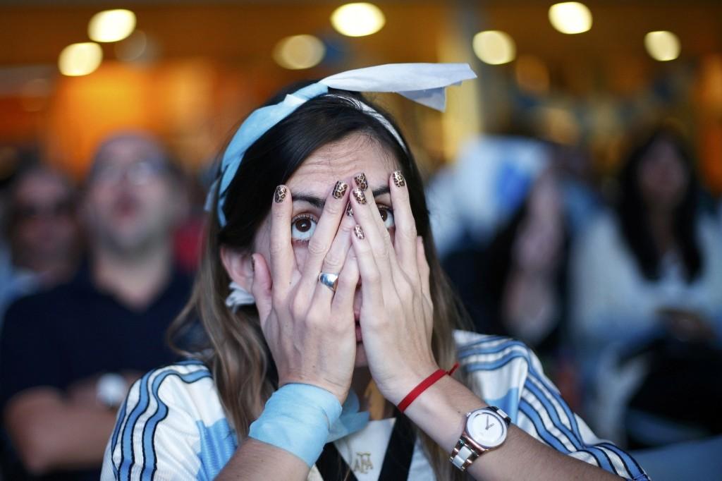 A fan of Argentina reacts while watching broadcast at the Argentine Embassy in Brasilia. REUTERS/Ueslei Marcelino