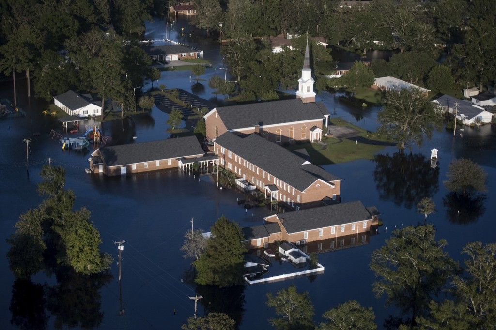 Flood waters inundate a church after Hurricane Florence struck Conway, S.C. AP Photo/Sean Rayford