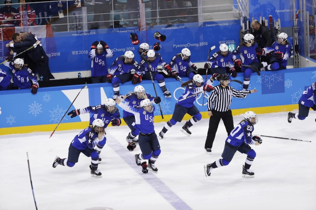 United States celebrates winning the women's gold medal hockey game against Canada. AP Photo/Matt Slocum