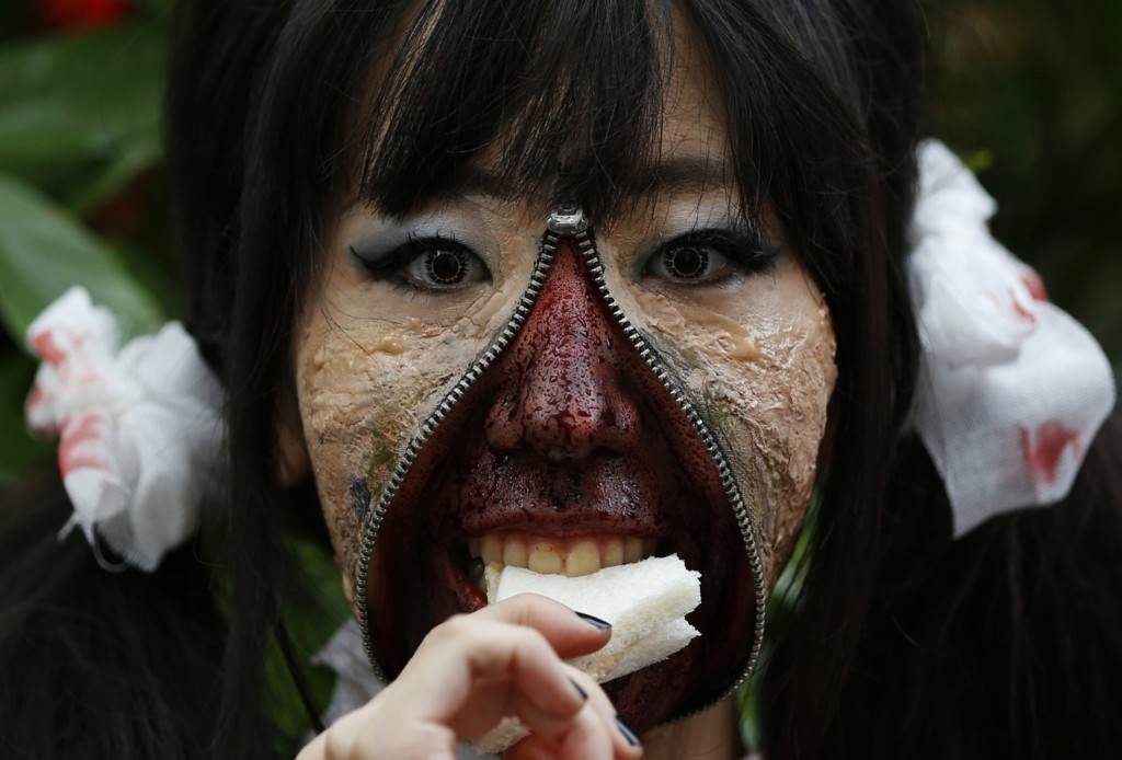 A participant eats a sandwich after a Halloween parade in Kawasaki, south of Tokyo. REUTERS/Yuya Shino