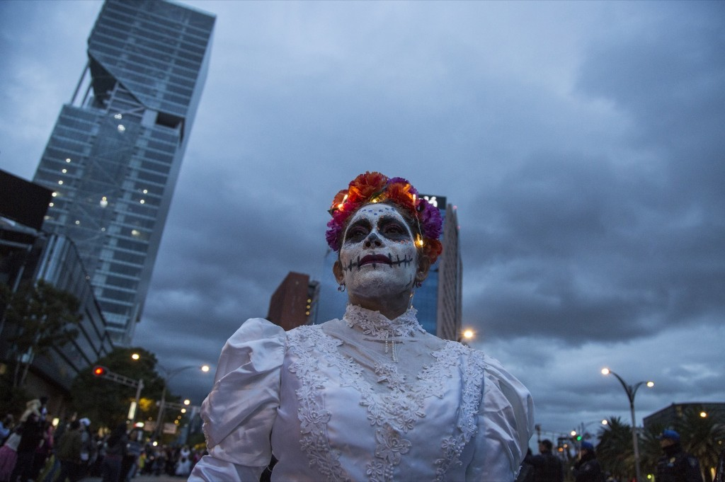 Hundreds of people dressed as Catrinas walked through Paseo de la Reforma in Mexico City. Cristopher Rogel Blanquet/Getty Images