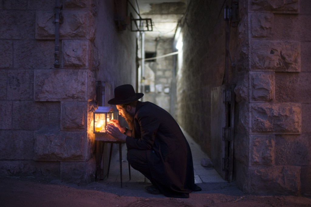 Lighting candles on the fifth night of Hanukkah in Jerusalem. Uriel Sinai/Getty Images