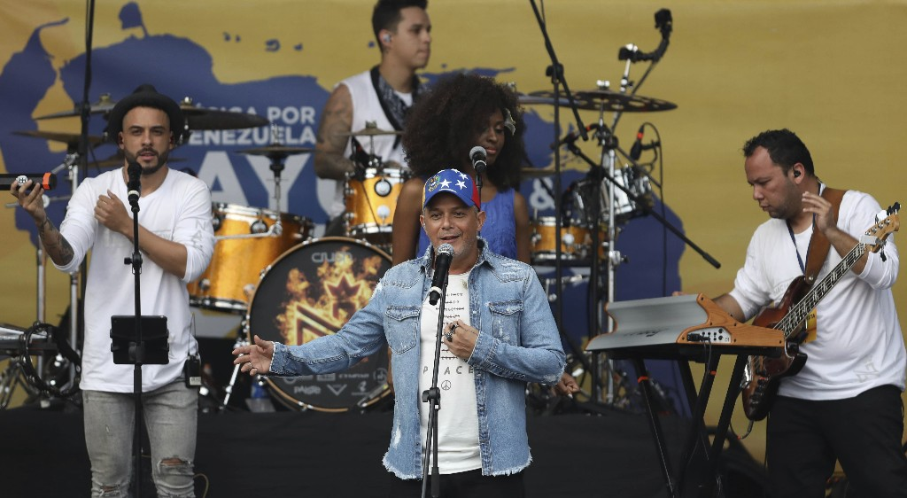 Spanish singer Alejandro Sanz performs in the Venezuela Aid Live concert on the Colombian side of the Tienditas International Bridge near Cucuta, Colombia, on the border with Venezuela, Friday, Feb. 22, 2019. (AP Photo/Fernando Vergara)