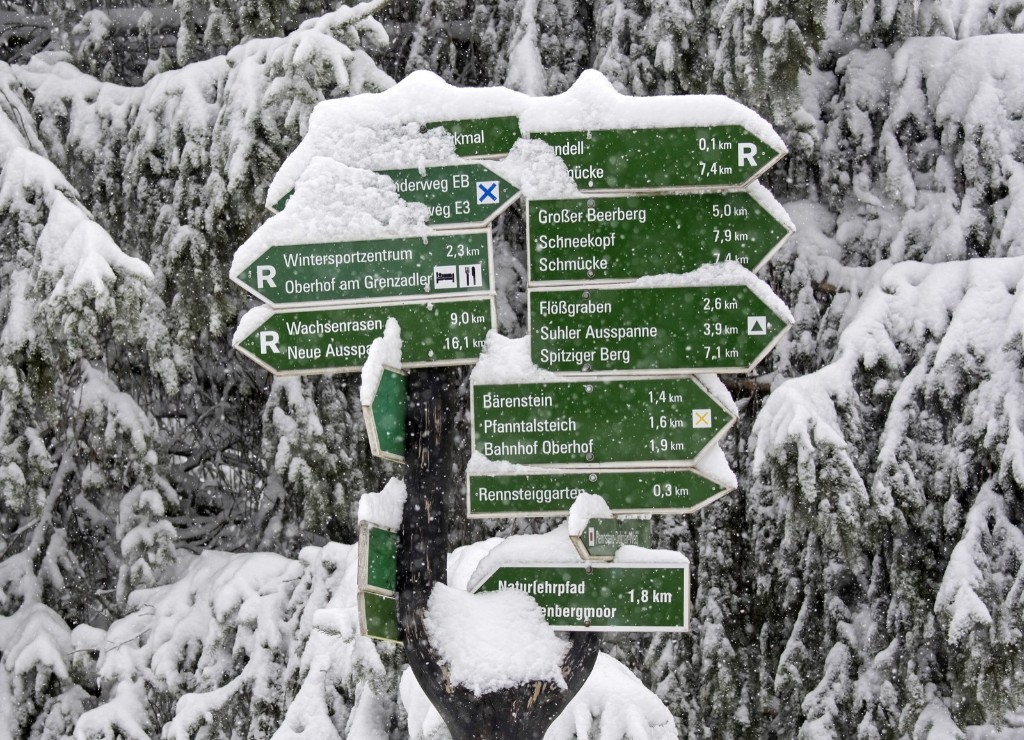 Snow-covered direction signs in the Thuringian Forest near Oberhof, Germany. AP Photo/Jens Meyer