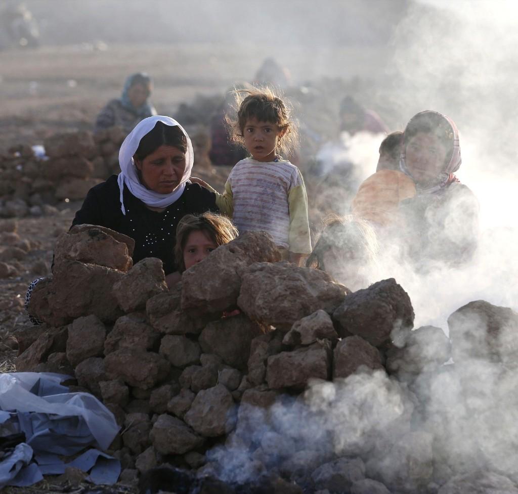 Yazidis prepare tea for breakfast at the Bajed Kadal refugee camp. REUTERS/Youssef Boudlal