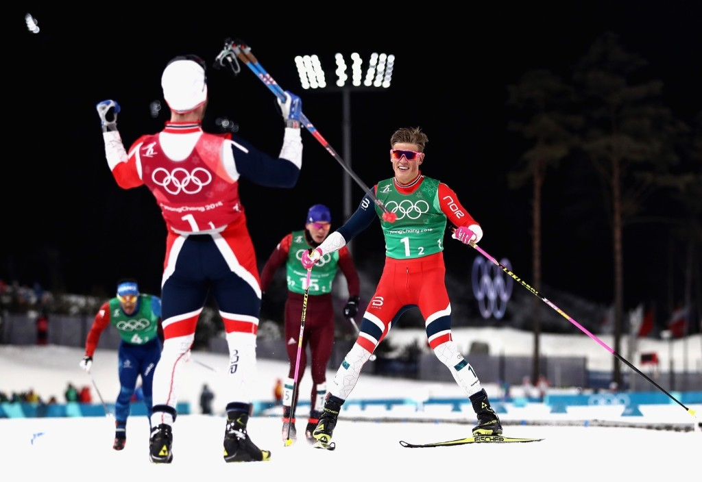Johannes Hoesflat of Norway crosses the finish line to win gold with teammate Martin Johnsrud Sundby of Norway during the cross country men's team sprint freestyle. Lars Baron/Getty Images