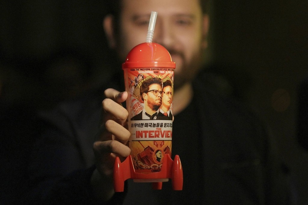 """The Interview"" souvenir cup at the Silent Movie Theatre before a midnight screening of ""The Interview"" in LA, Dec. 25. REUTERS/Jonathan Alcorn"