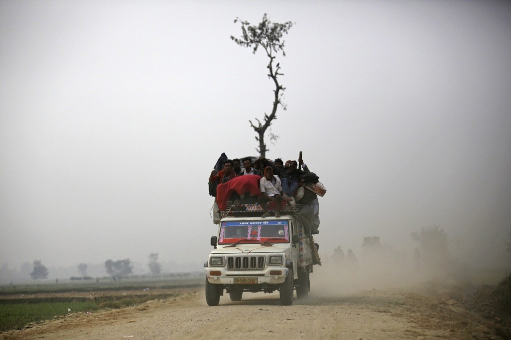 "An overloaded vehicle returning from the ""Gadhimai Mela"" festival held in Bariyapur, Nepal. REUTERS/Navesh Chitrakar"
