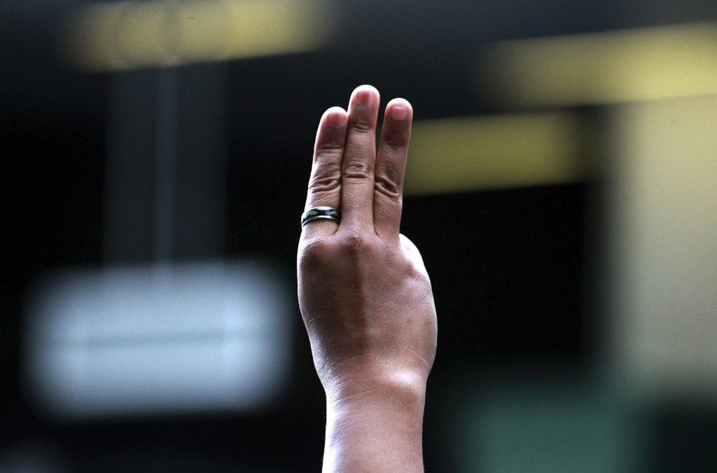 A protester flashes the Hunger Games' three-finger salute during an anti-coup demonstration in Bangkok. AP Photo/Wason Wanichakorn