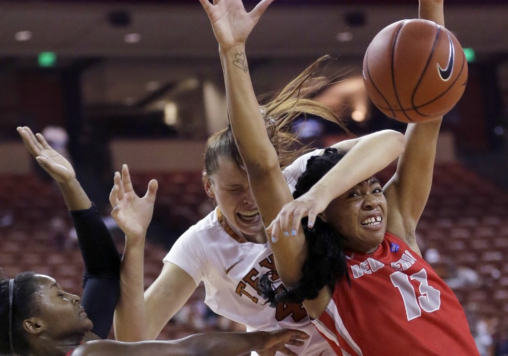 Kelsey Lang of Texas is tangled up with New Mexico's Bryce Owens and Khadijah Shumpert as they scramble for a rebound during college basketball game in Austin. AP Photo/Eric Gay