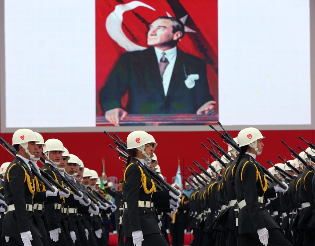 Turkish War Academy students parade during celebrations on Republic Day in Ankara. An image of Turkey's founder Mustafa Kemal Ataturk is in the background. AP Photo/Burhan Ozbilici